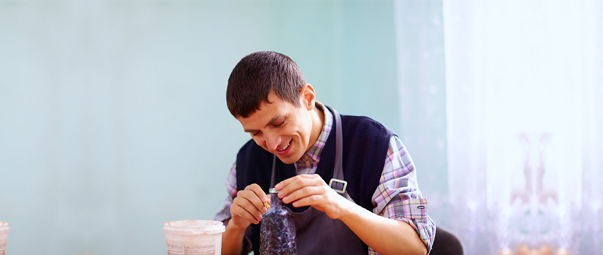 man with disability engaged in craftsmanship on practical lesson