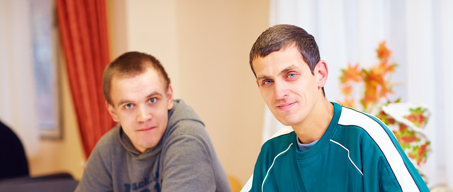 two men with disability smiling