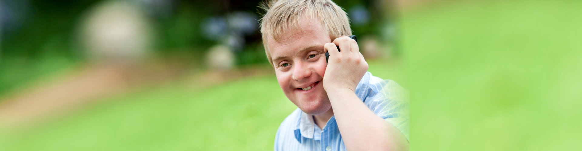 Happy boy calling someone on the phone